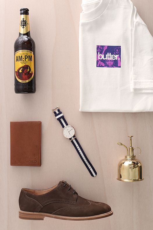 Gifts for Him  AM:PM craft beer from The Beer Library. Brown Passport found at Rob the Rich Collection pop-up store. Vanishing Elephant mens shoes stocked at Stencil Store. Buttergoods logo tee from DeadSet store. Brass gold indoor plant watering can by The Foxes Den & Mens Daniel Wellington watch by Mrs Smith Loves, both from the Collective.  #mensfashion #design #homewares #danielwellignton #thecolombo #christchurch #newzealand