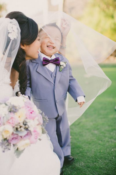 He's so happy to be kissed by the bride!