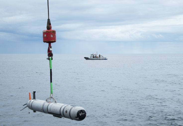 Mine Countermeasures Evolving Towards Mix-And-Match Capabilities Personnel  Sailors assigned to Explosive Ordnance Disposal Mobile Unit (EODMU) 2 and Expeditionary Mine Countermeasures Company (ExMCM Co.) 202 stand by in a rigid-hull inflatable boat as a Mark 18. Mod. 2 unmanned underwater vehicle (UUV) is lowered into the water during a ExMCM training exercise on Aug. 42017.US Navy photo.  ANNAPOLIS Md.  The Navy is trending towards a mix-and-match set of people platforms and sensorsto…