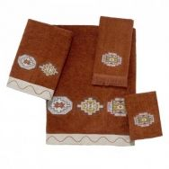 Tangine Bath Linens  This sheared velour set of towels boldly feature southwestern patterns on each towel.  Bath towel and hand towel feature  designs with a cream colored band at base.  Fingertip towel features pattern with frayed ends.  Available in Copper or Mocha.  Pieces sold individually.  Machine wash warm.  Do NOT bleach