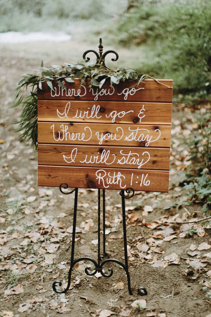 Cute bible verse signage at this woodsy wedding reception | Image by Anni Graham Photography