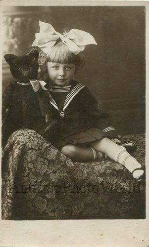 little girl with a big bow, Steiff  bear & chaise lounge