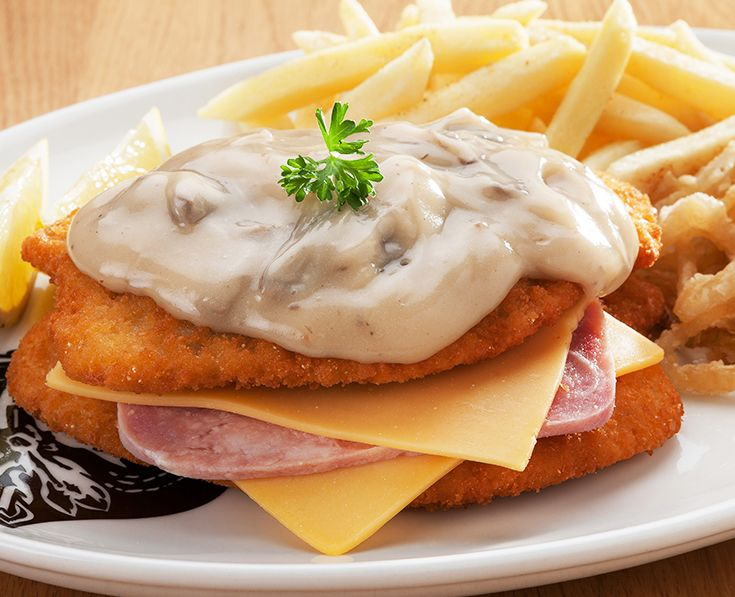 Scnitzel Stacker: Ham and cheese sandwiched between 2 tender crumbed chicken breast fillets, topped with creamy mushroom sauce. Read more: https://www.spur.co.za/menu/schnitzel-and-seafood/