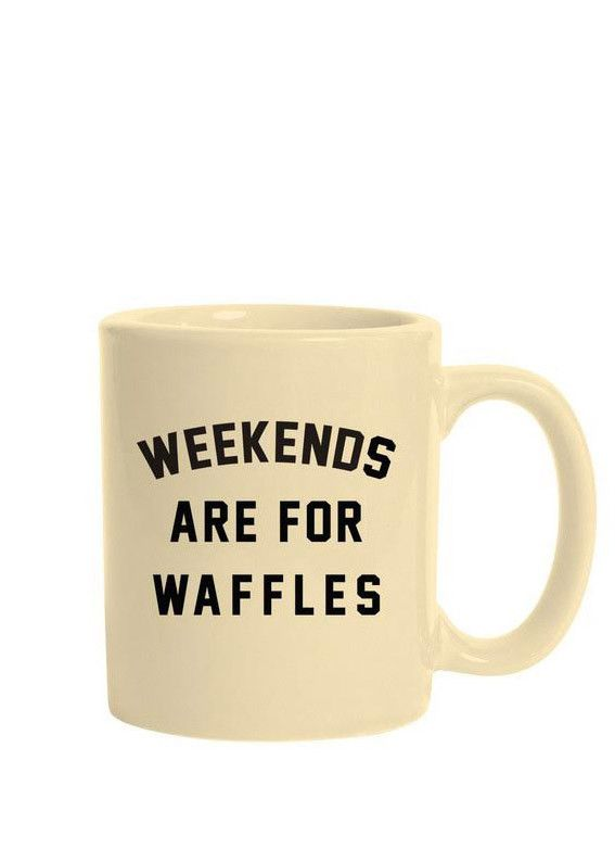 """The Weekends are for Waffles traditional mug is made of ceramic composite and is a glossy """"almond"""" color. Each side of the high quality, c-curved handle mug is screen printed with """"Weekends are for Wa"""