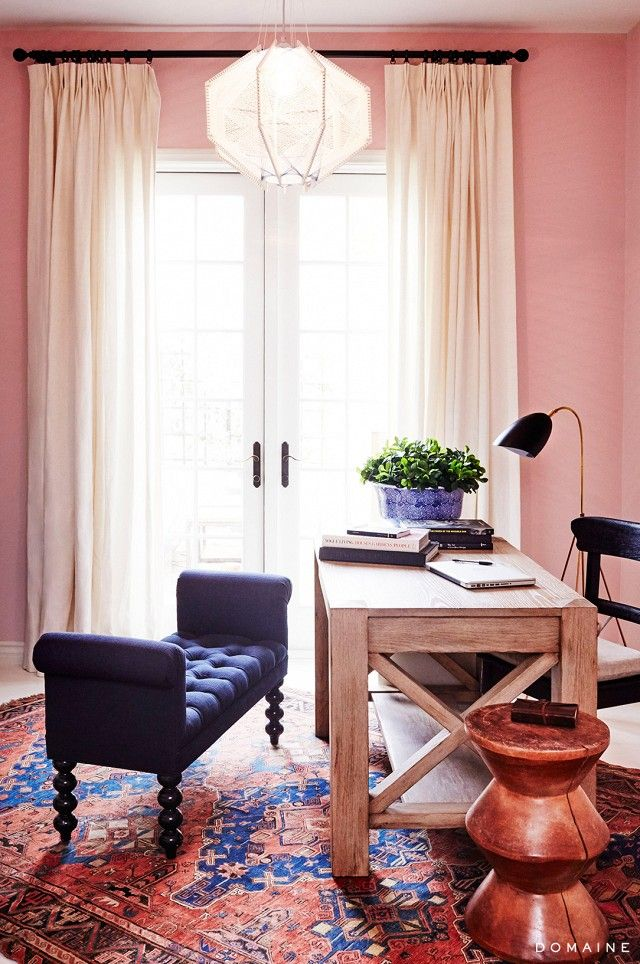"With pale rose-colored walls, a Turkish rug, and beautiful rustic handmade wooden desk, Foster's home office is an exciting new space for the comedy writer, who works from home. ""I..."