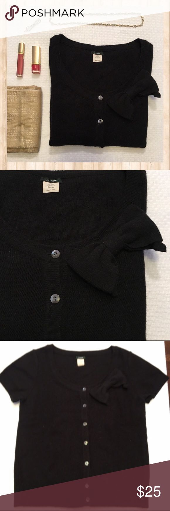 J. Crew Valerie Bow black short sleeve cardigan J. Crew black short sleeve bow cardigan.  Wool and cashmere blend.  Has some pilling as pictured in the 5th photo.  All prices are negotiable so 💕Make offers💕 🚫No trades🚫 J. Crew Sweaters Cardigans