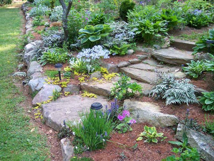 Rock edge garden google search gorgeous gardens for Sloped rock garden designs