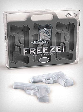 "FREEZE! Guns Ice Cube Tray    Drink your White Russian like a true spy would with these ""FREEZE!"" gun shaped ice cubes! Just fill the flexible silicone rubber tray with water (or your favorite fruit juice), freeze, and voila - a fun way to cool your favorite drink. They also make super cute Jell-O bites for a cool confection on a hot day, or try filling with melted chocolate for a sweet treat! Makes 6 pistol shaped ice cubes.  * Food Grade Silicone Rubber"
