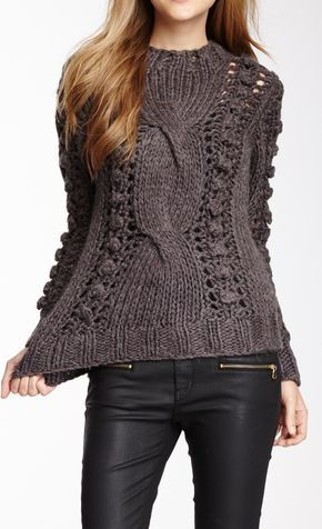 very cool and unique cable knit sweater and I like it paired with the leather pants