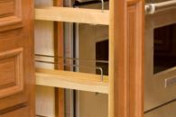 Custom Cabinetry by Kent Moore Cabinets.  Spice rack.  Maple wood with Golden Nutmeg Stain finish