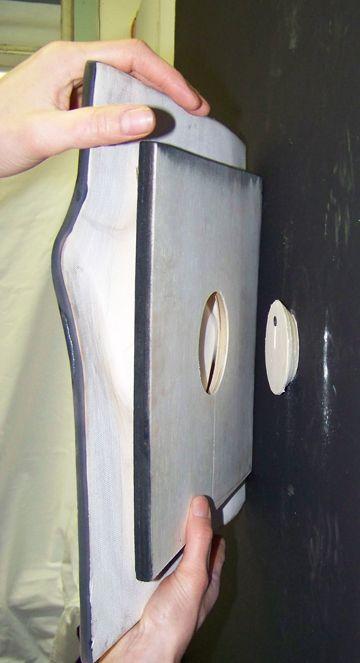 ceramic wall art installation and hanging - natalie blake studios