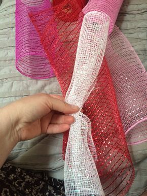 Step-by-step instructions to make a curly Deco-Mesh wreath. Red, white, and pink works for Valentine's Day, but mix it up for other holidays and seasons!