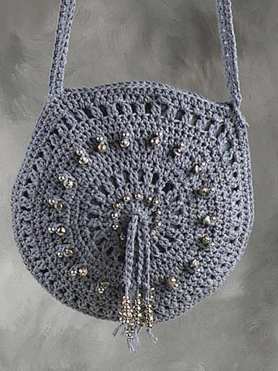 """Crochet this cute bag and belt combo to go with anything ... anywhere! Bag size: 11"""" across, belt is 1 1/4"""" wide x desired length. Skill Level: Beginner"""
