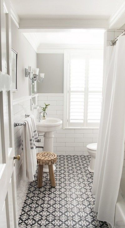 Bathroom with white subway tile and patterned encaustic floor tiles, designed by Vintage Scout Interiors, via @sarahsarna.