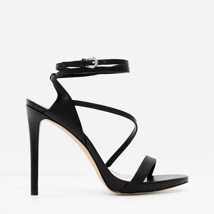 Opentoe strappy black sandals featuring a diagonal strap design Double  ankle strap fastens with a metal buckle closure