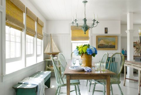 The owner of this historic Nantucket cottage found her dining room's late-1800s farm table and reproduction Windsor chairs at Nantucket House Antiques. The verdigris chandelier is by Richard Mulligan.