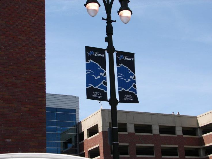 If you find yourself in downtown Detroit, MI, near Ford Field, you'll see a great example of our BannerFlex street banner hardware in action. Used in conjunction with our Kalamazoo Banner Works banners, you'll see the familiar Lion's Honolulu blue branding on streets surrounding the stadium. When fans approach the area, our street banners are one of the first signs that let them know they've arrived. From that initial jolt of excitement to walking back out to their car, our street banners…