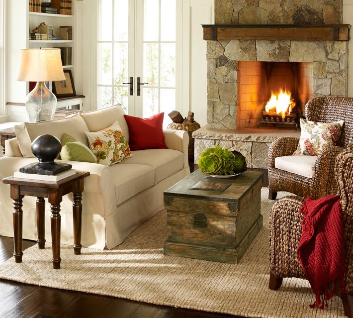 Love: Living room, fireplace, seagrass wingback armchairs.   Pottery Barn