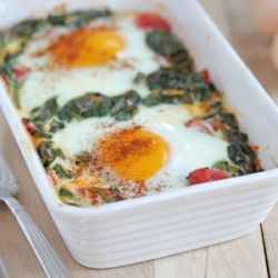 Eggs over spinach, tomatos and garlic but in little ramekins as another egg dish #saveur breakfast for #dinnerparty
