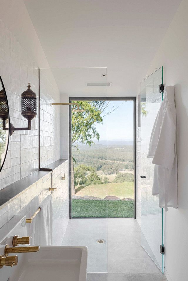 """Forget the standalone tub—This year, it's all about showers that boast an unbeatable view. Houzz declares """"showers that feel outdoor"""" will be the biggest bathroom trend of the year. """"To get..."""