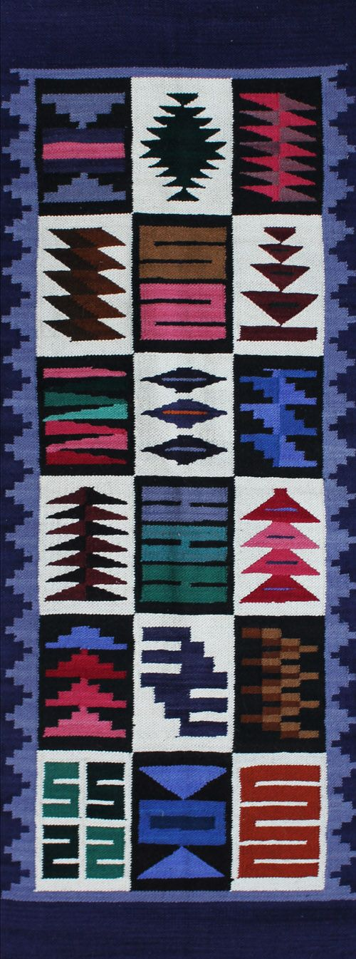 "rug #: 2-106  type:   Peruvian Weaving  origin: Peru  size: 1'11"" x 5'1""    This runner's geometric rendering of a traditional Inca calendar design is beautifully executed with a cool, well balanced palette of brightly saturated colors on a white ground."