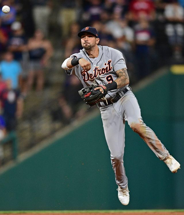 Tigers' Nick Castellanos throws out Indians' Carlos Santana at first based in the eighth inning.