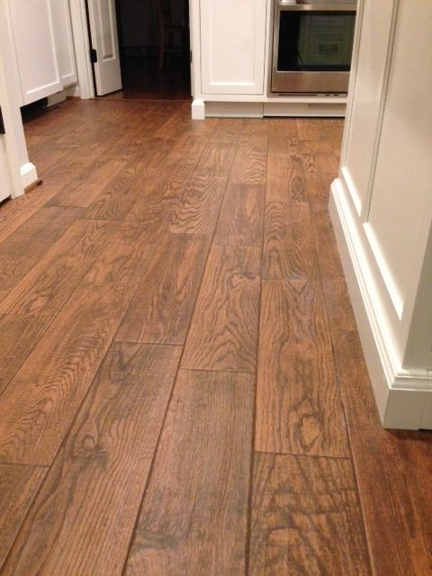 Flooring; Marrazzi Gunstock Oak porcelain tile, Home Depot sable brown sanded grout which looked too dark when it first went on but then dried to this complementary color that does not easily show dirt