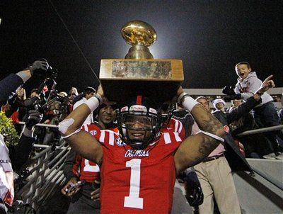 ole miss football 2012 egg bowl - Randall Mackey holds the Egg Bowl Trophy with pride