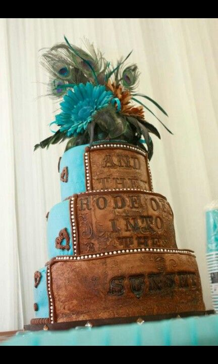 """Turquoise and brown wedding cake I made for my son. I made the topper too. It says """" and they rode off into the sunset"""""""
