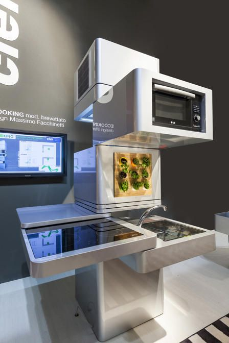 The Ecooking kitchen from Clei encapsulates a number of trends that Yahoo Homes saw at the world-renowned Salone del Mobile furniture fair, recently concluded in Milan: It's streamlined, multipurpose, transformable, space-efficient -- and secretive, hiding its functionality beneath a slick gleam.