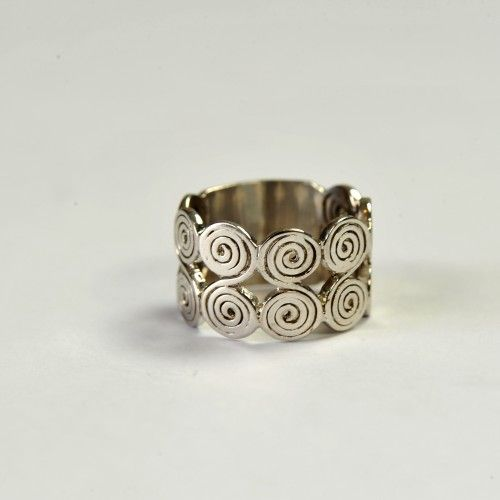 Antique handmade ring made of silver. It has a round shape and has some round lines crafted on it.