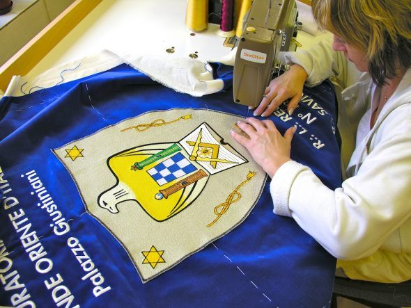 Our employee is sewing the flag for freemasons.