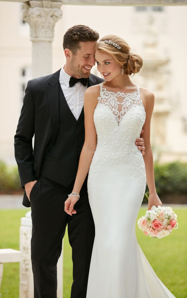 This high neck sheath wedding dress by Stella York is a bride's dream! Lace and crepe create a sophisticated column silhouette that flatters your shape.