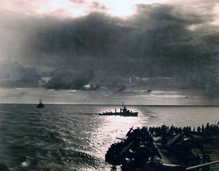Operation Torch, November 1942. U.S. destroyer cuts through the wake of a U.S. aircraft carrier on patrol, first day of fighting off North Africa, November 8. Official U.S. Navy Photograph, now in the collections of the National Archives.