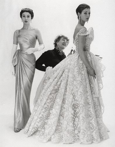 designer Elspeth Champcommunal of Worth (first editor of British Vogue and founding member of Inc Soc) with models wearing her creations. Photo by Norman Parkinson, 1953