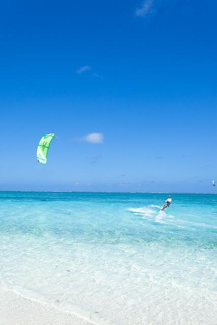 Impressively skilled kite surfers, Hatenohama Beach, the 11km long coral sand cay Kume Island, Okinawa, Japan by ippei + janine, via Flickr #kitesurfing #kiteboarding #kitetravel #actiontripguru