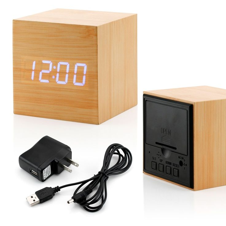 Add a touch of modern to your bedroom, living room or office. This alarm clock displays time, date, temp and also has an alarm. It can be plugged in via USB or powered by 3 AA batteries (not included)