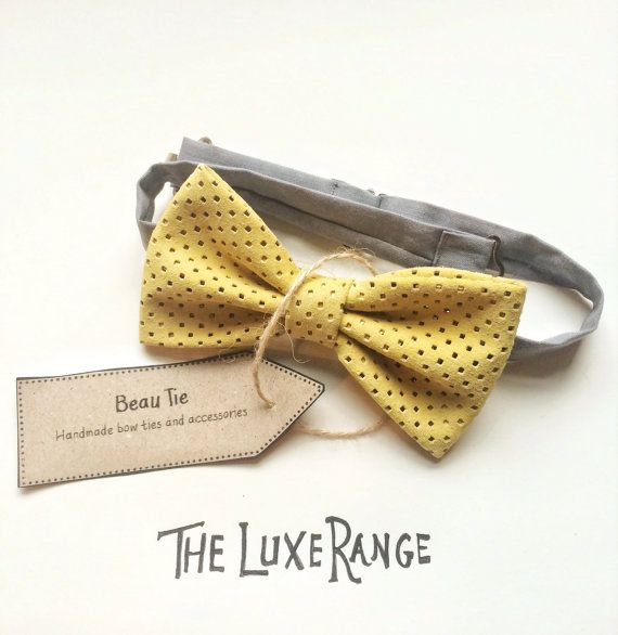 men's bow tie handmade from yellow suede with cut out details, a luxury item.