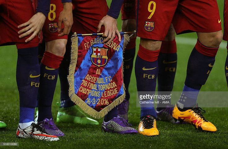The FC Barcelona and Arsenal match pennant before the UEFA Champions League match between FC Barcelona and Arsenal at Camp Nou on March 16, 2016 in Barcelona, Spain.