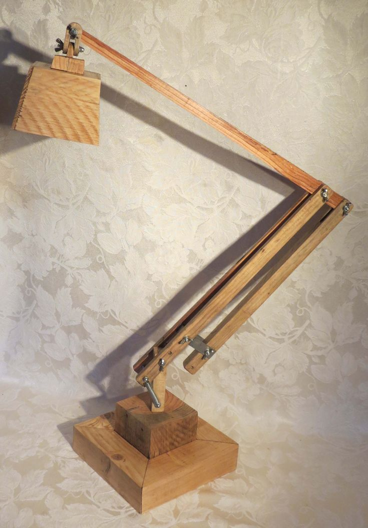 Wooden angle poise lamp made from pallet wood.