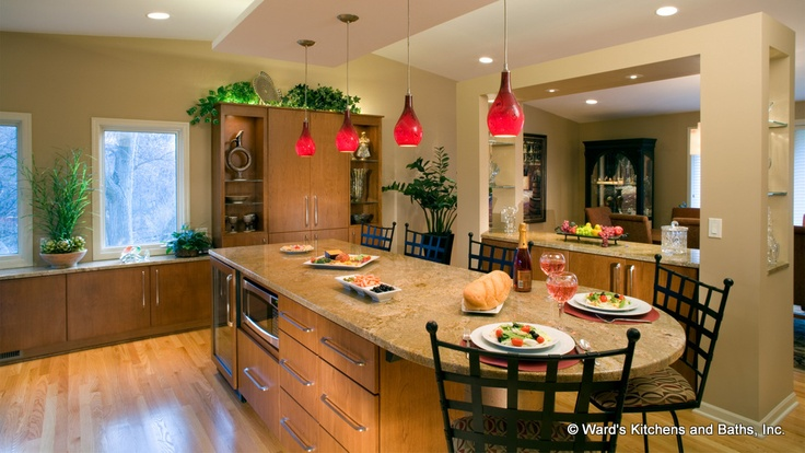 Large Kitchen Island With Cherry Cabinets Granite Countertop And Red Pendant Lights Hanging