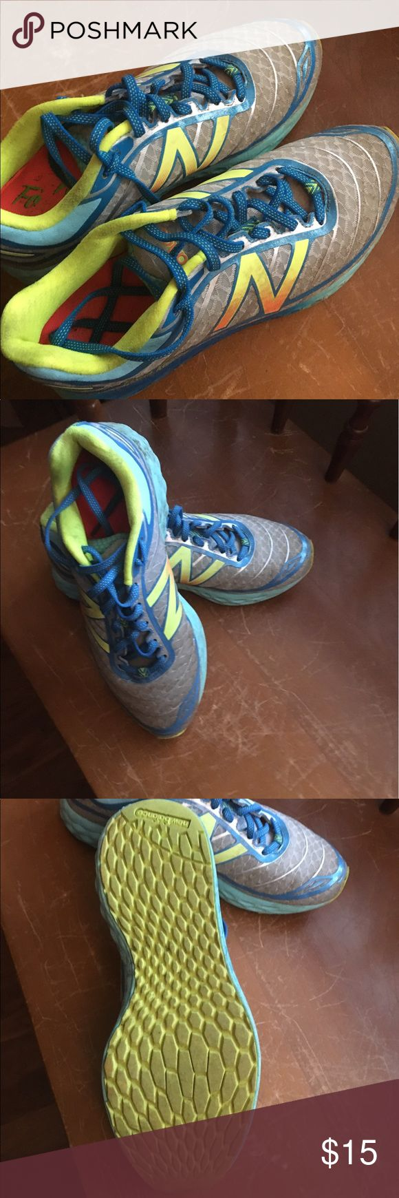 Women's New Balance Shoes Lightly worn new balance/walking running shoes.  Very good condition however they do have some dirt on them.  Colors are neon yellow, light blue, gray and orange.  I do not have the box. New Balance Shoes Sneakers