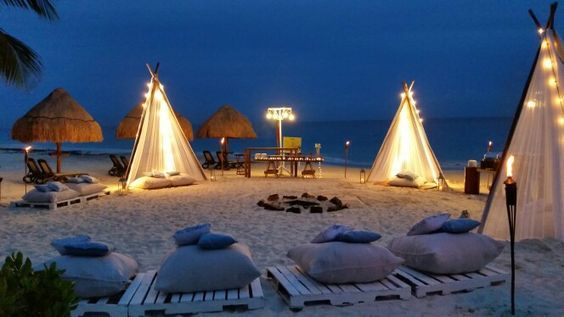 A Beach Bonfire is a fun treat for your guests! #DreamsRivieraCancun
