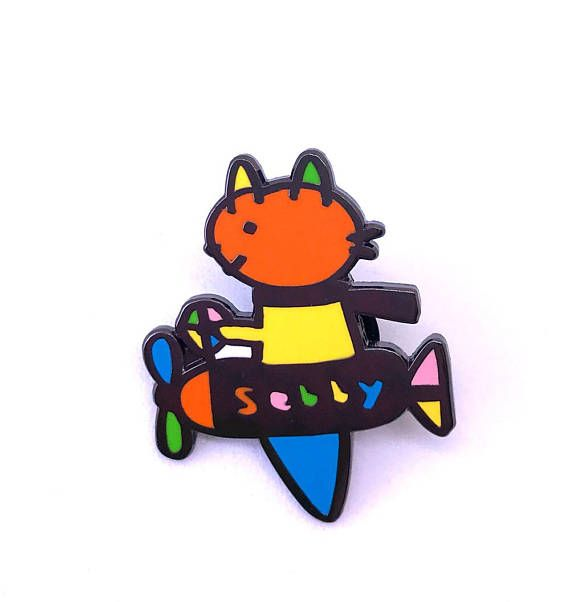 Sebby plane enamel pin   Come explore the skies with Sebby the cat!