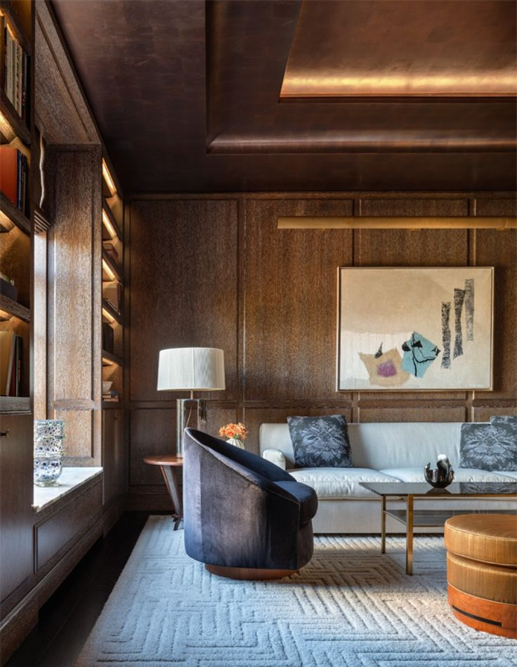 Library of upper east side apartment overlooking the frick library living warm wood paneling and ceiling contemporary architectural details modern by thad