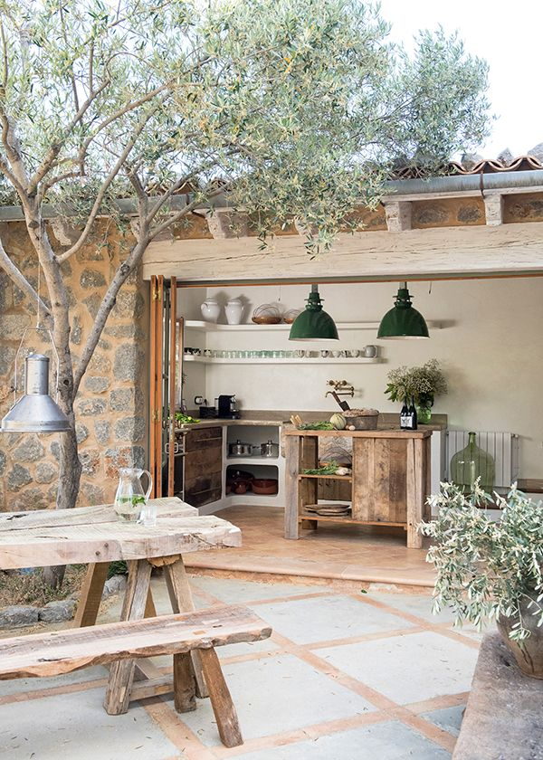 This home on the island of Mallorca (Spain) has been designed by Spanish architectural firm Moredesign. Building the rustic stone house was a process over time as it was important to build with respec