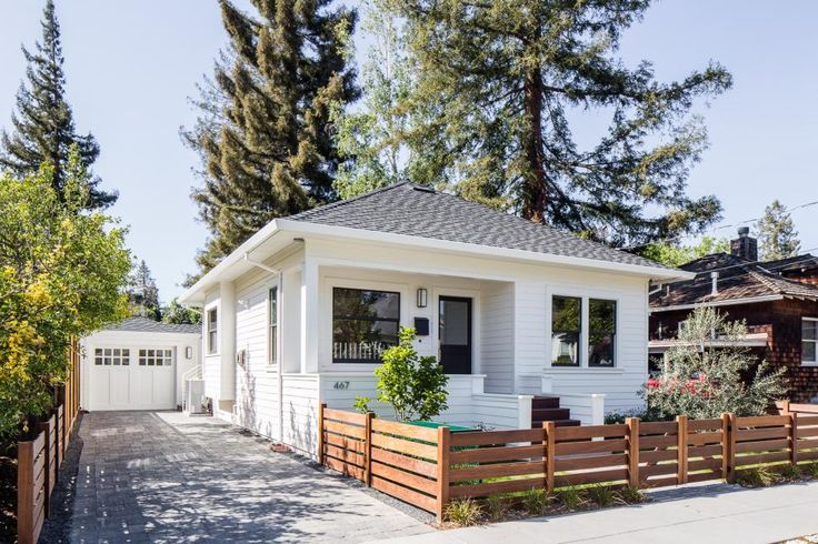 The interior of this home was designed to feel like a recreation of a darling bungalow in Napa Valley, Calif. A white, gray and black color palette is a perfect choice for the outside of the home to brighten, enlarge and homogenize its external elements.