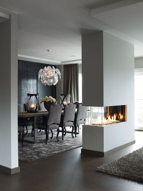 I love the idea of a separation wall with an inbuilt fire which creates a feeling of warmth throughout especially against the light, soft grey paint. I love the idea of using various shades of one colour in a room because it allows variation but still keeps it very simple in the sense that it almost matches and nothing is too complicated in the room.