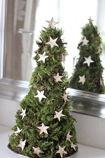 christmas tree from moss decorated with stars made from birch-bark