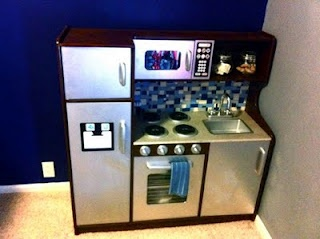 A toy kitchen with a back splash and stainless steel appliances?! Awesome. But is it cruel for me to say that my daughter's kitchen will be made out of cardboard and paint?